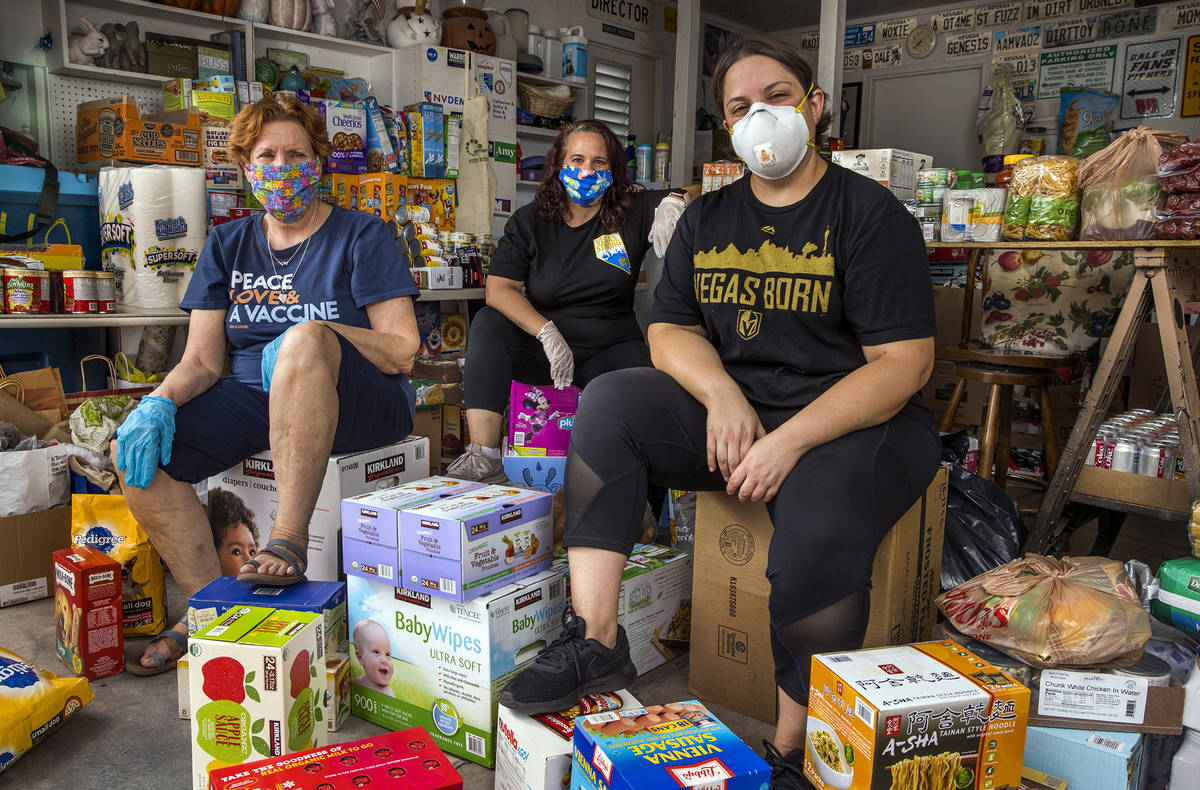 Donna West, from left, Jeana Blackman Taylor and Annette Magnus with donations in West's garage ...