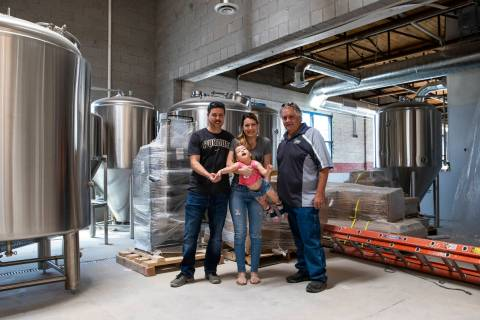 Jason, Lauren and daughter Ariana Taylor with brewmaster Ken Hallyburton at Nevada Brew Works i ...