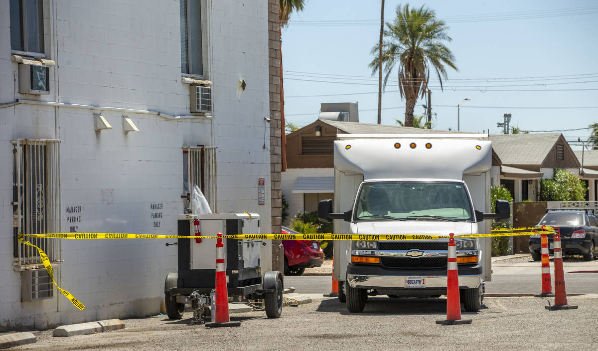 Caution tape blocks off equipment from Earth Resource Group Environmental Services working insi ...