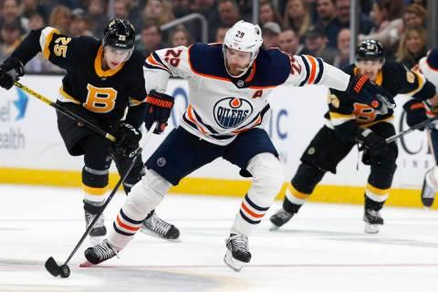 Edmonton Oilers' Leon Draisaitl (29) brings the puck up in front of Boston Bruins' Brandon Carl ...