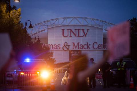 Protesters march by the Thomas and Mack Center as police escort them during a Black Lives Matte ...