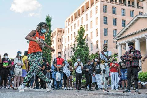 A group of dancers perform during a protest over the death of George Floyd, Sunday, May 31, 202 ...