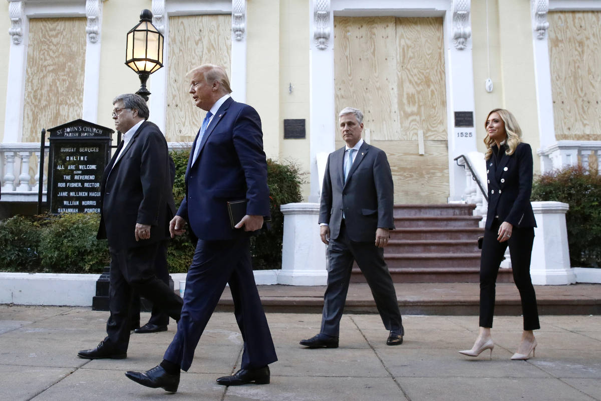President Donald Trump departs after visiting outside St. John's Church across Lafayette Park f ...