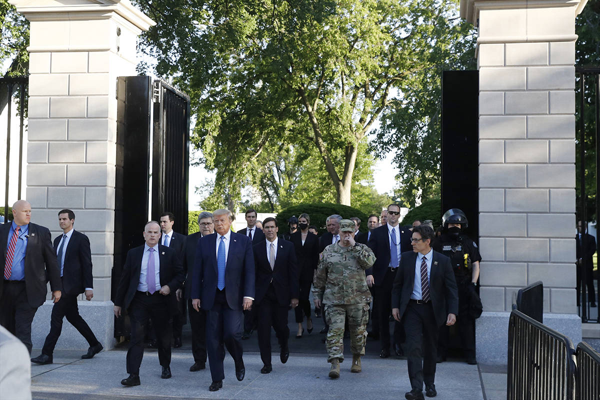 President Donald Trump walks from the gates of the White House to visit St. John's Church acros ...