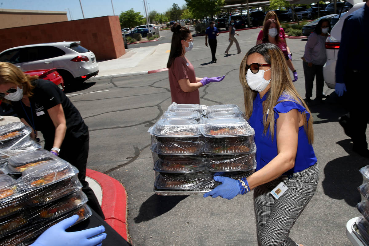 Comprehensive Cancer Centers of Nevada Connie Gutierrez, office manager, loads lunches donated ...