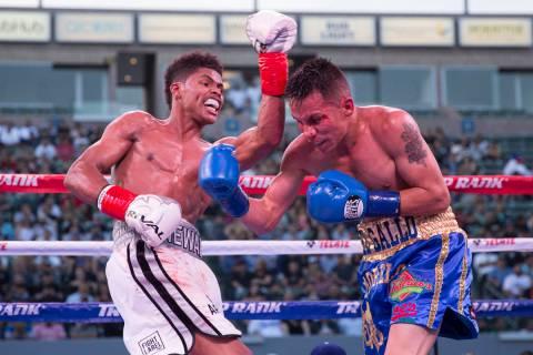 Shakur Stevenson, left, battles Edgar Brito in their WBO World Championship bout at the StubHu ...