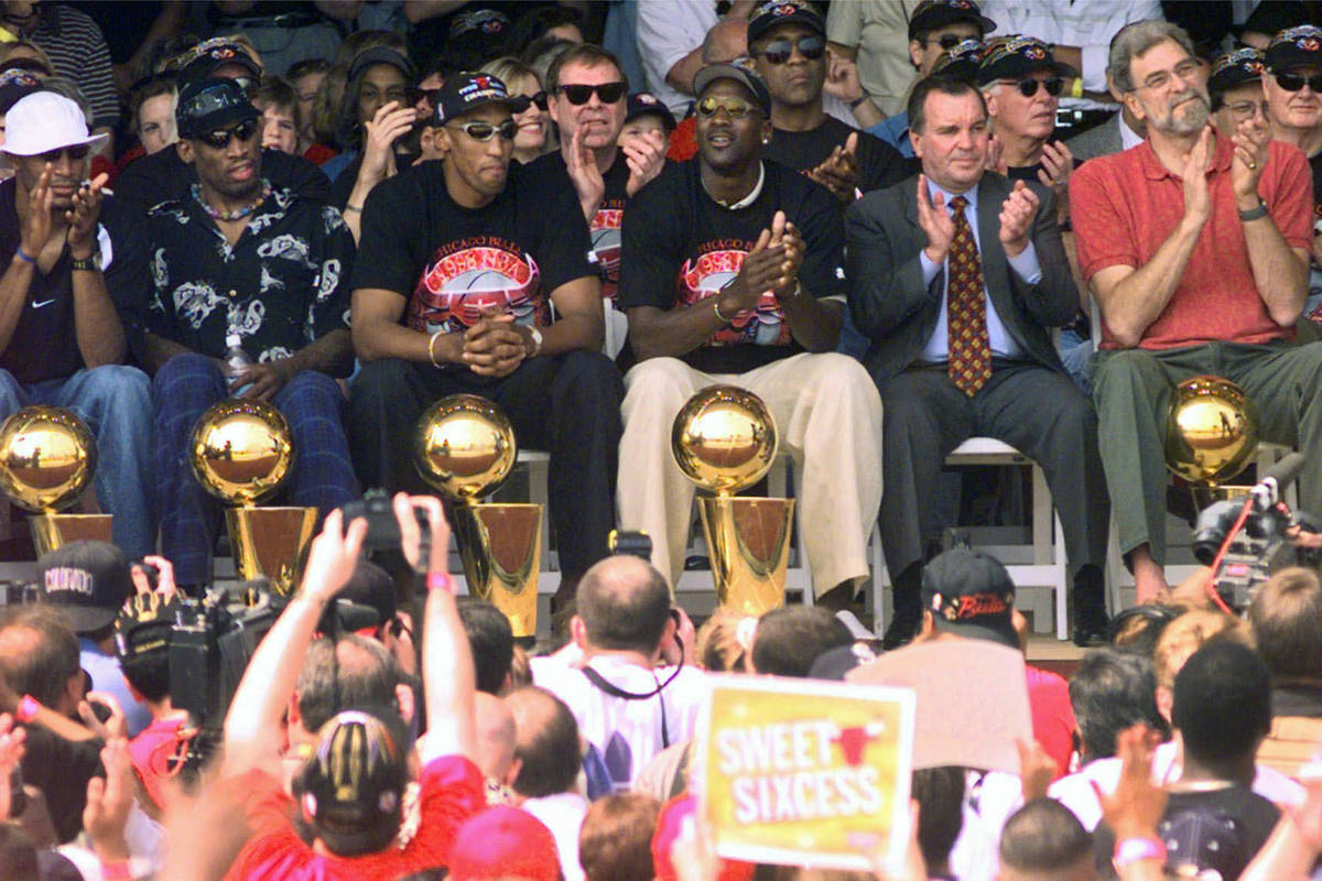 In this June 16, 1998, file photo, NBA Champions, from left: Ron Harper, Dennis Rodman, Scottie ...