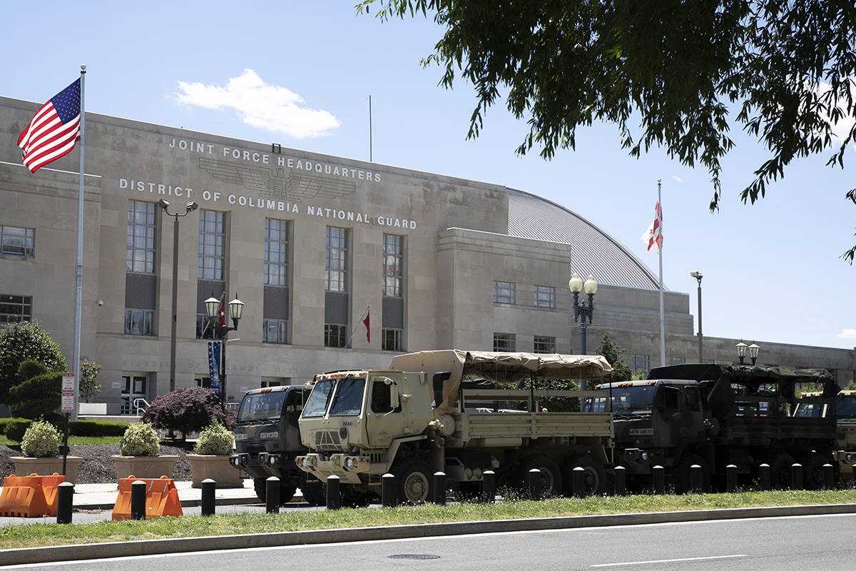 Vehicles for the District of Columbia National Guard are seen outside the D.C. Armory, Monday, ...
