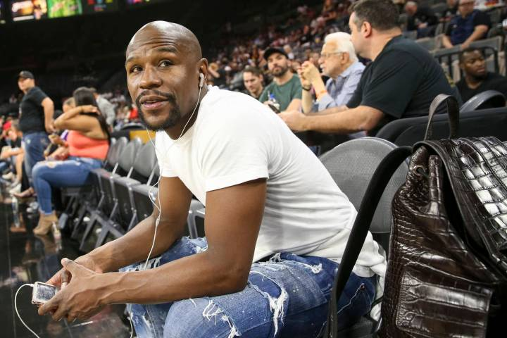 Boxer Floyd Mayweather attends the Las Vegas Aces and Los Angeles Sparks WNBA basketball game a ...