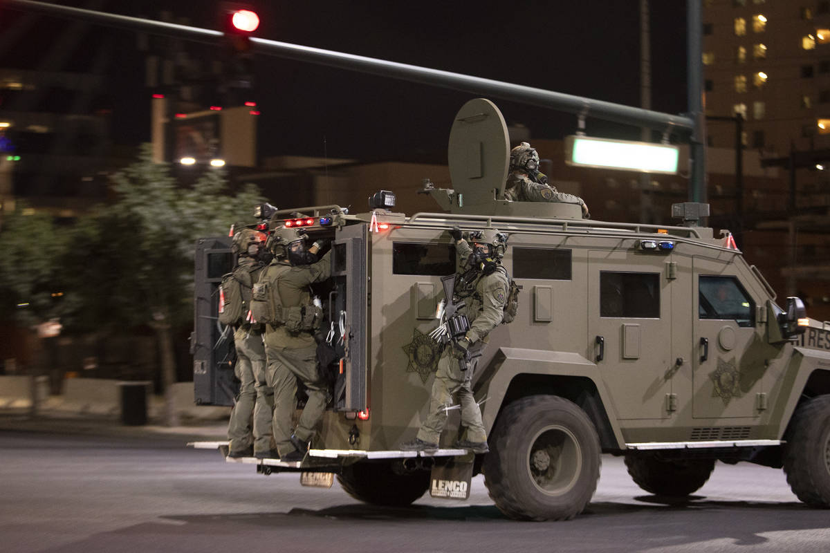 A National Guard truck makes way into downtown as protesters moved from the Strip to Fremont St ...