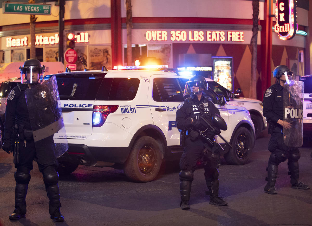 State patrol officers ready themselves to disperse protesters outside of Fremont Street Experie ...