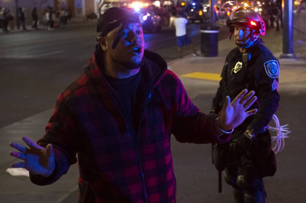 A protester argues with police during an event organized by Black Lives Matter in downtown Las ...