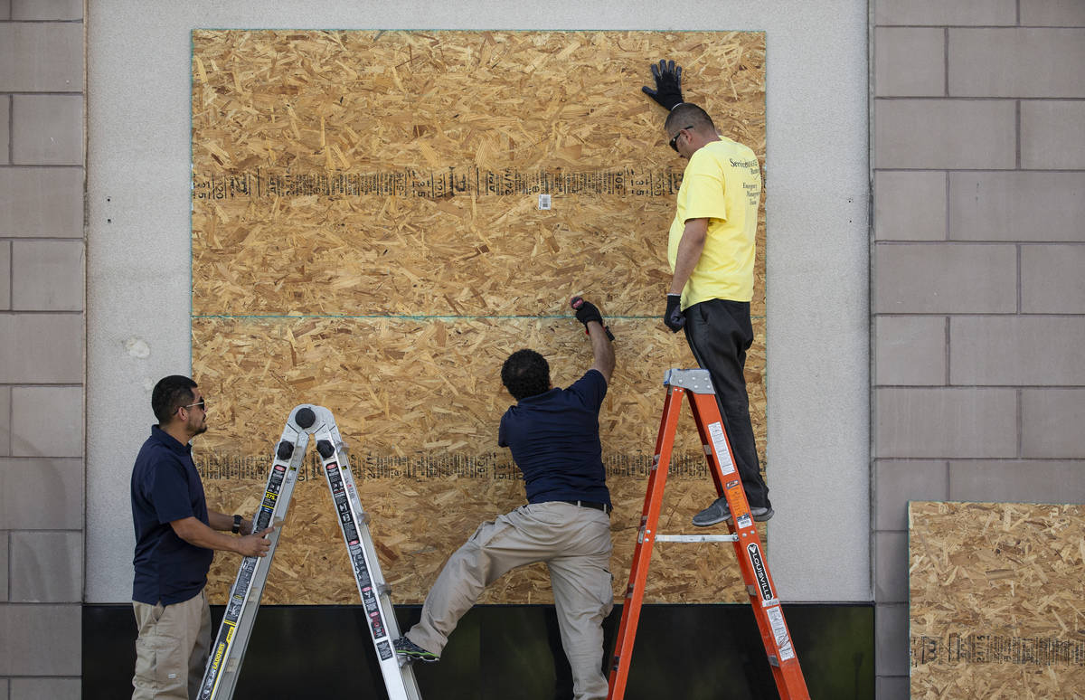 Windows are boarded up at Fashion Show mall in preparation for protests on the Strip on Monday, ...