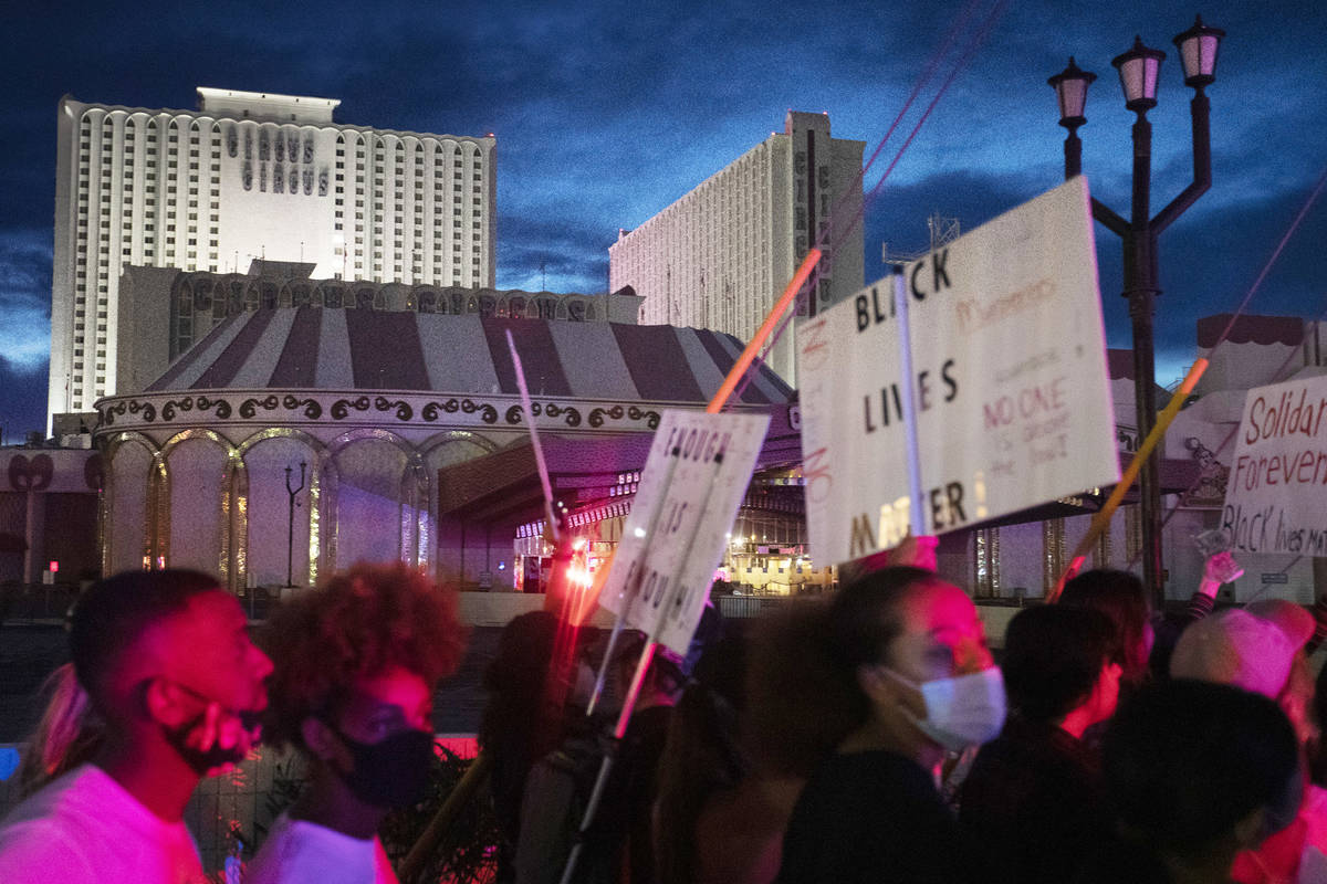 Protestors make way down Las Vegas Boulevard past Circus Circus in support of George Floyd, who ...