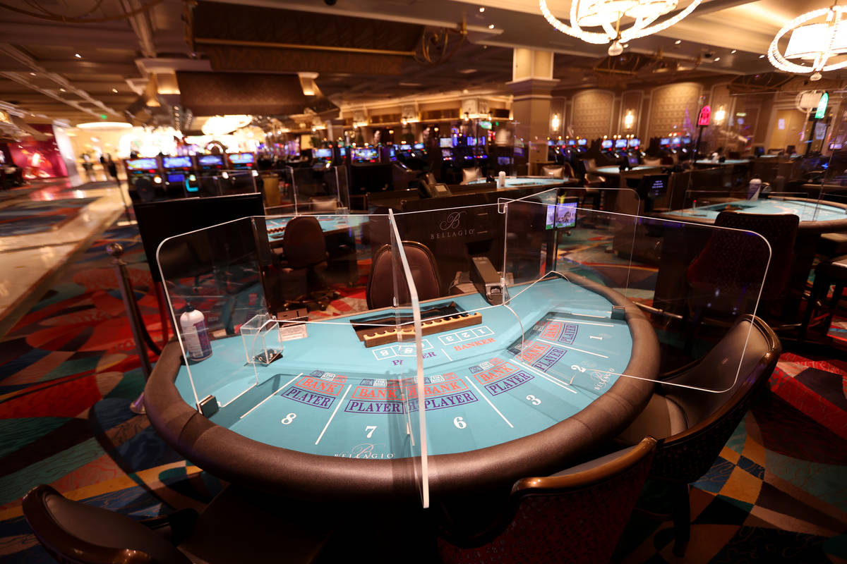 """A baccarat table with plexiglass dividers at Bellagio during a media a tour showing """"healt ..."""
