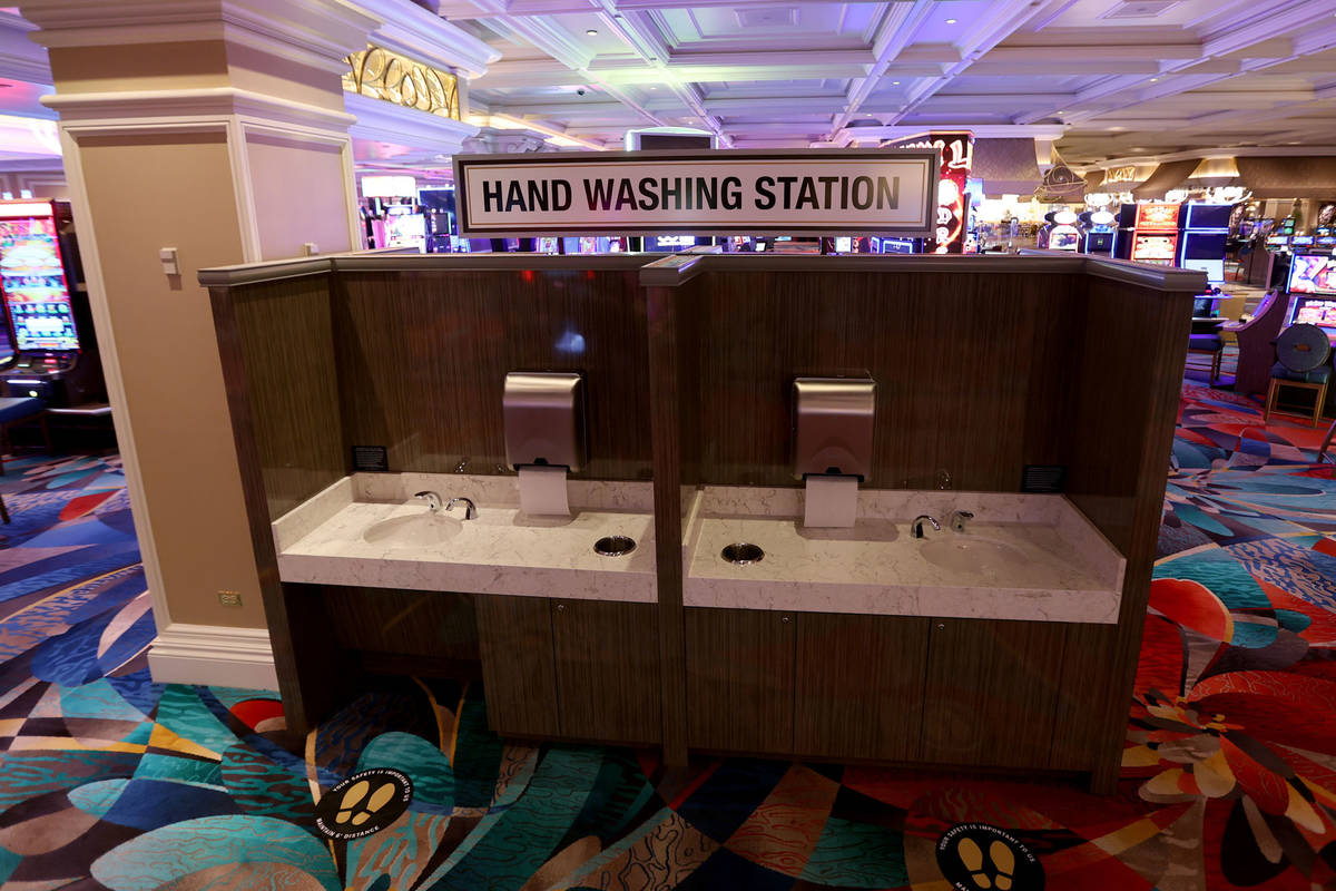 """New hand washing stations on the casino floor during a Bellagio media a tour showing """"heal ..."""