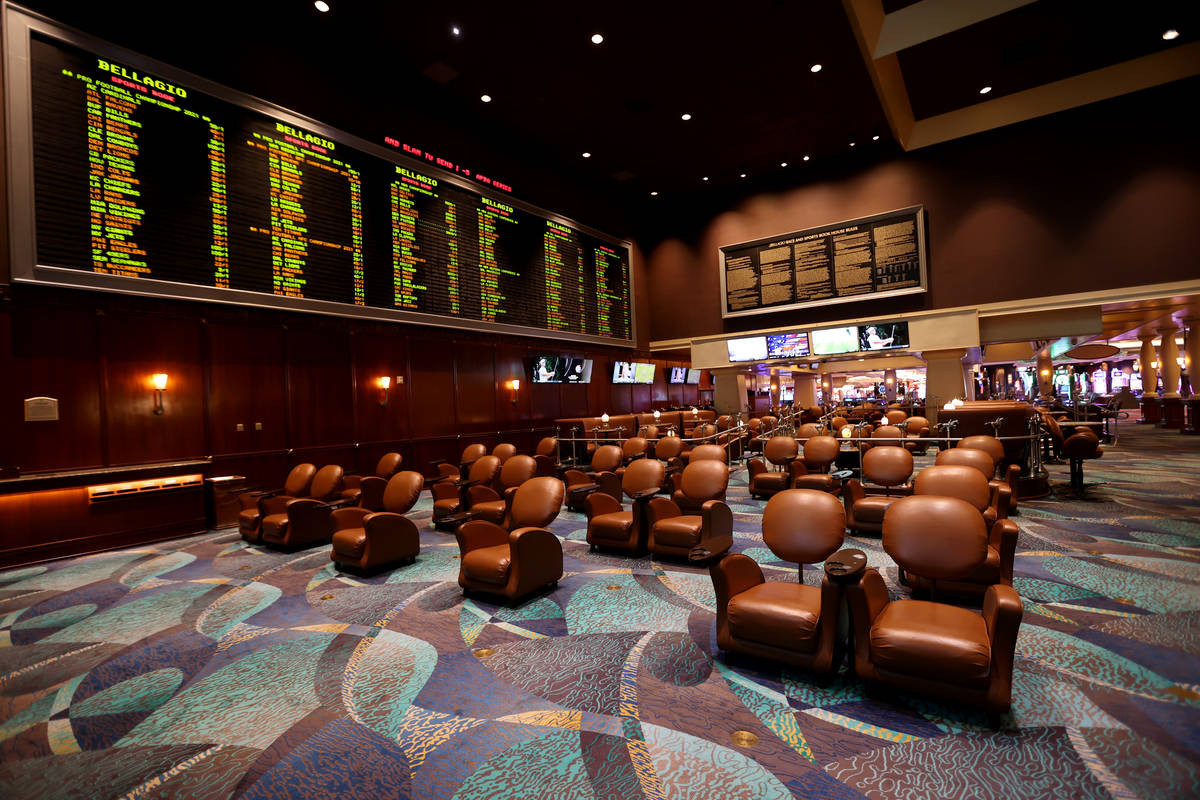 """Sportsbook seats are socially distanced during a Bellagio media a tour showing """"health and ..."""