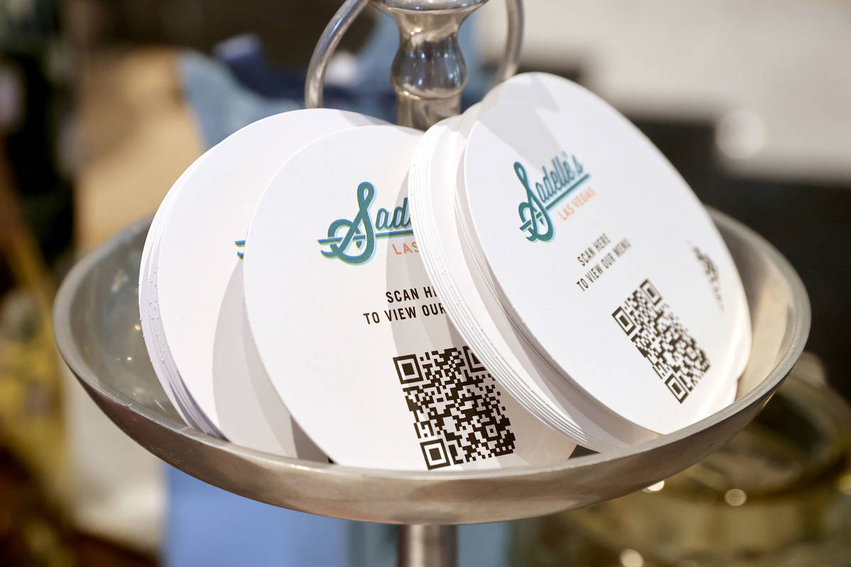 Coasters with QR code for the menu at SadelleÕs at Bellagio during a media a tour showing ...