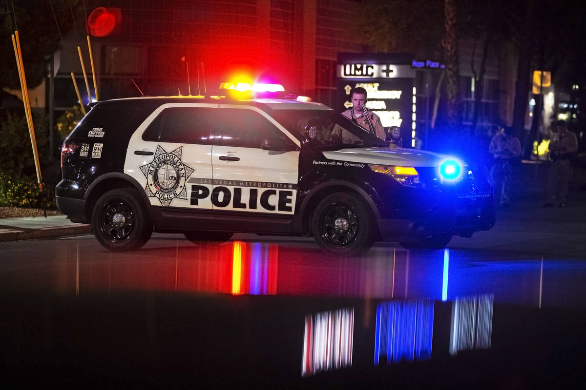 A group of Las Vegas police officers wait outside University Medical Center after an officer wa ...