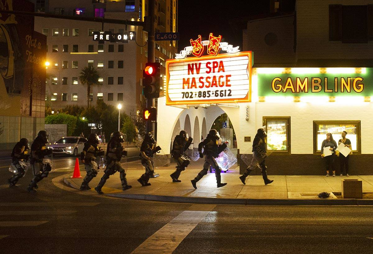 Police race down Fremont Street during a protest organized by Black Lives Matter in downtown La ...