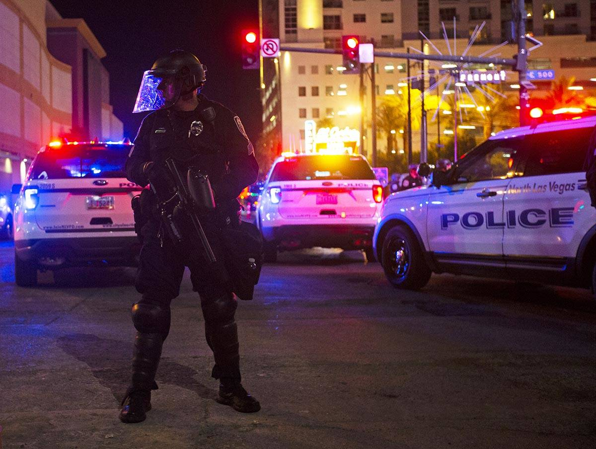 Police patrol Fremont Street during a protest organized by Black Lives Matter in downtown Las V ...