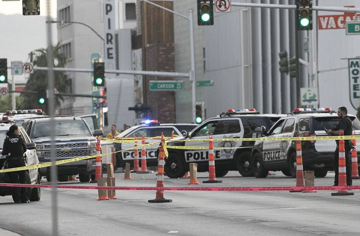 Las Vegas police investigate after a man was fatally shot outside the Lloyd George U.S. Courtho ...