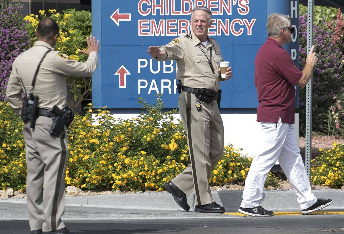 Clark County Sheriff Joe Lombardo waves to an officer as he leaves University Medical Center on ...