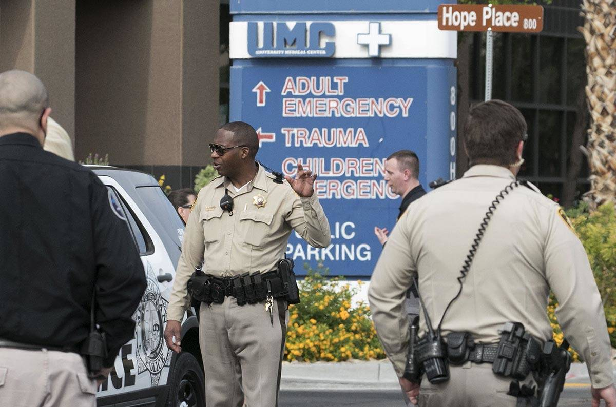Las Vegas police officers gather outside University Medical Center on Tuesday, June 2, 2020. A ...