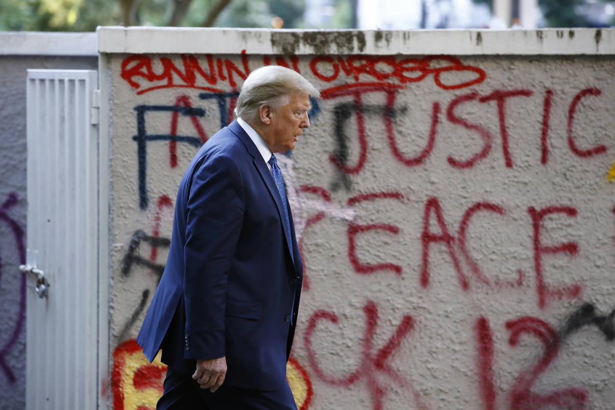 President Donald Trump walks from the White House through Lafayette Park to visit St. John's Ch ...
