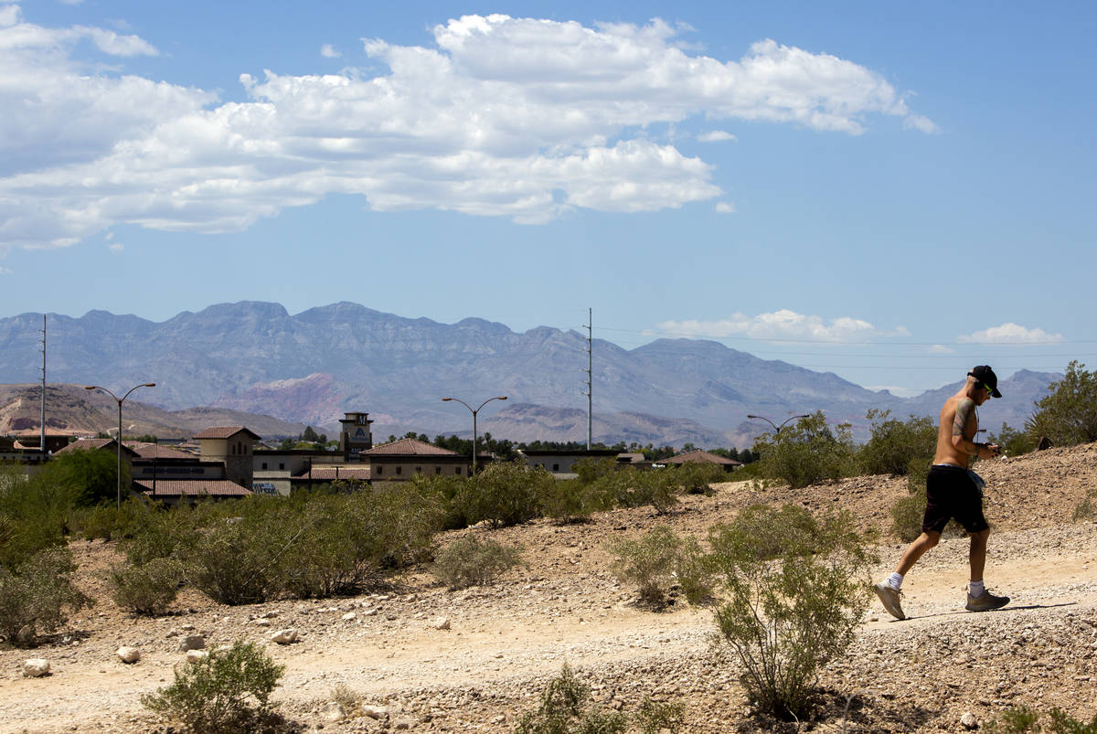 A man runs up the hill at Exploration Peak Park on Wednesday, May 27, 2020, in Las Vegas. The N ...