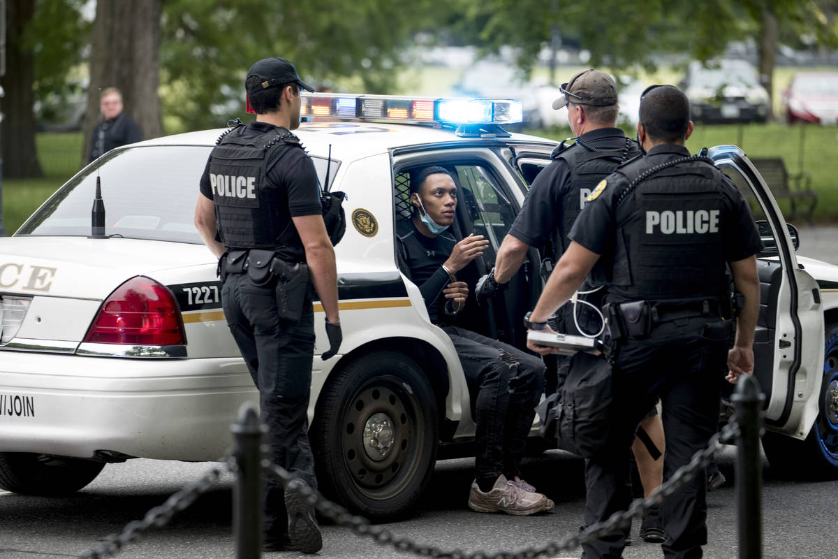 U.S. Secret Service police arrest a man for what one eye witness said an officer told him was f ...
