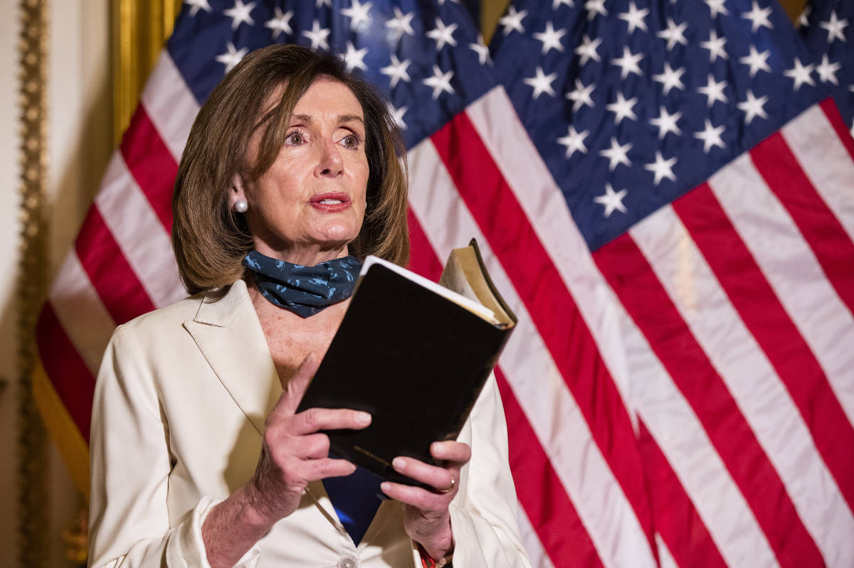 House Speaker Nancy Pelosi of Calif., reading from the Bible, reacts to President Donald Trump ...
