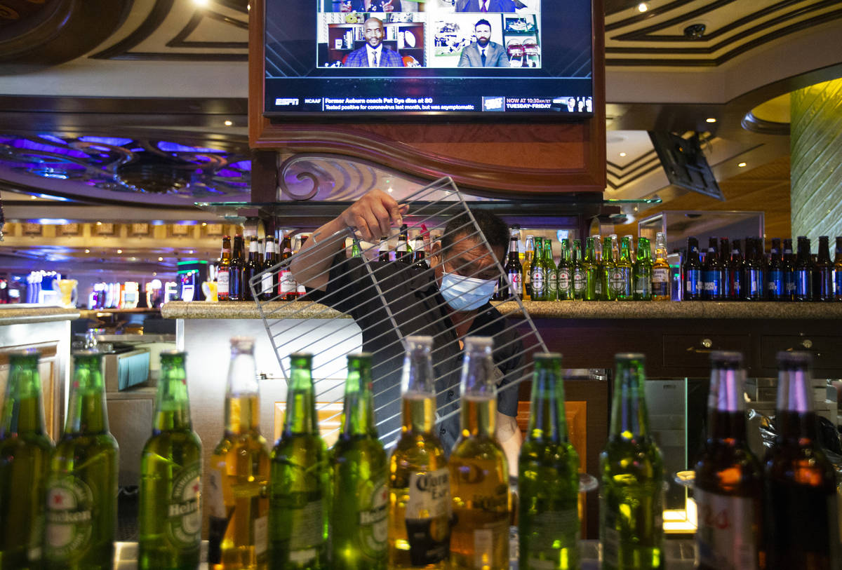 Bartender Antonio Argueea prepares his station to reopen at TI on Monday, June 1, 2020, in Las ...
