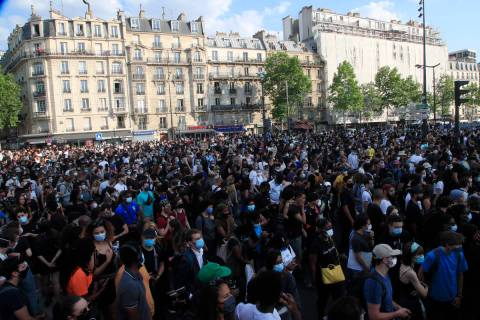 Protesters gather Tuesday, June 2, 2020 in Paris. Thousands of people defied a police ban and c ...