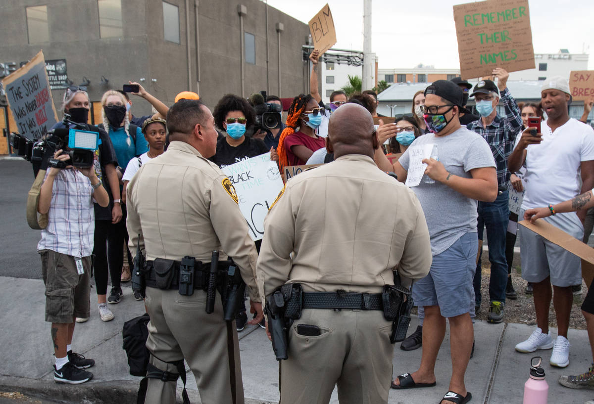 Las Vegas police speak with protesters to determine the route of the protest during a Black Liv ...