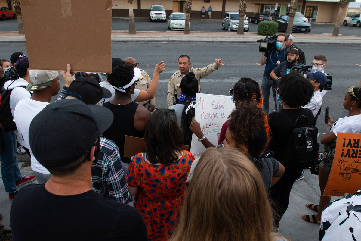 Protesters tell Las Vegas police officers where they intend to go during a Black Lives Matter p ...
