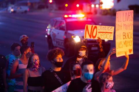 Protesters march as police escort them during a Black Lives Matter protest at UNLV in Las Vegas ...