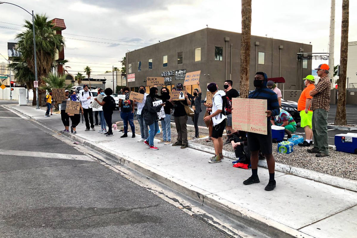 People gather for the Black Lives Matter protest Tuesday, June 2, 2020, at East Naples and Univ ...