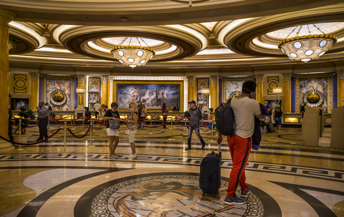 Guests begin to arrive and check in following re-opening ceremonies at Caesars Palace on Thursd ...