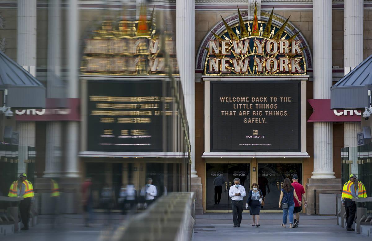 People walk across the pedestrian towards New York-New York on the Las Vegas Strip on Thursday, ...