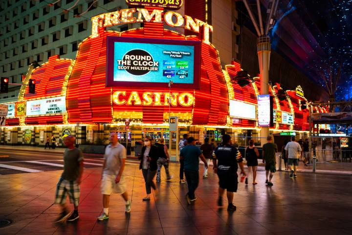 People cross Casino Center Boulevard outside of the Fremont as hotel-casinos reopen in downtown ...