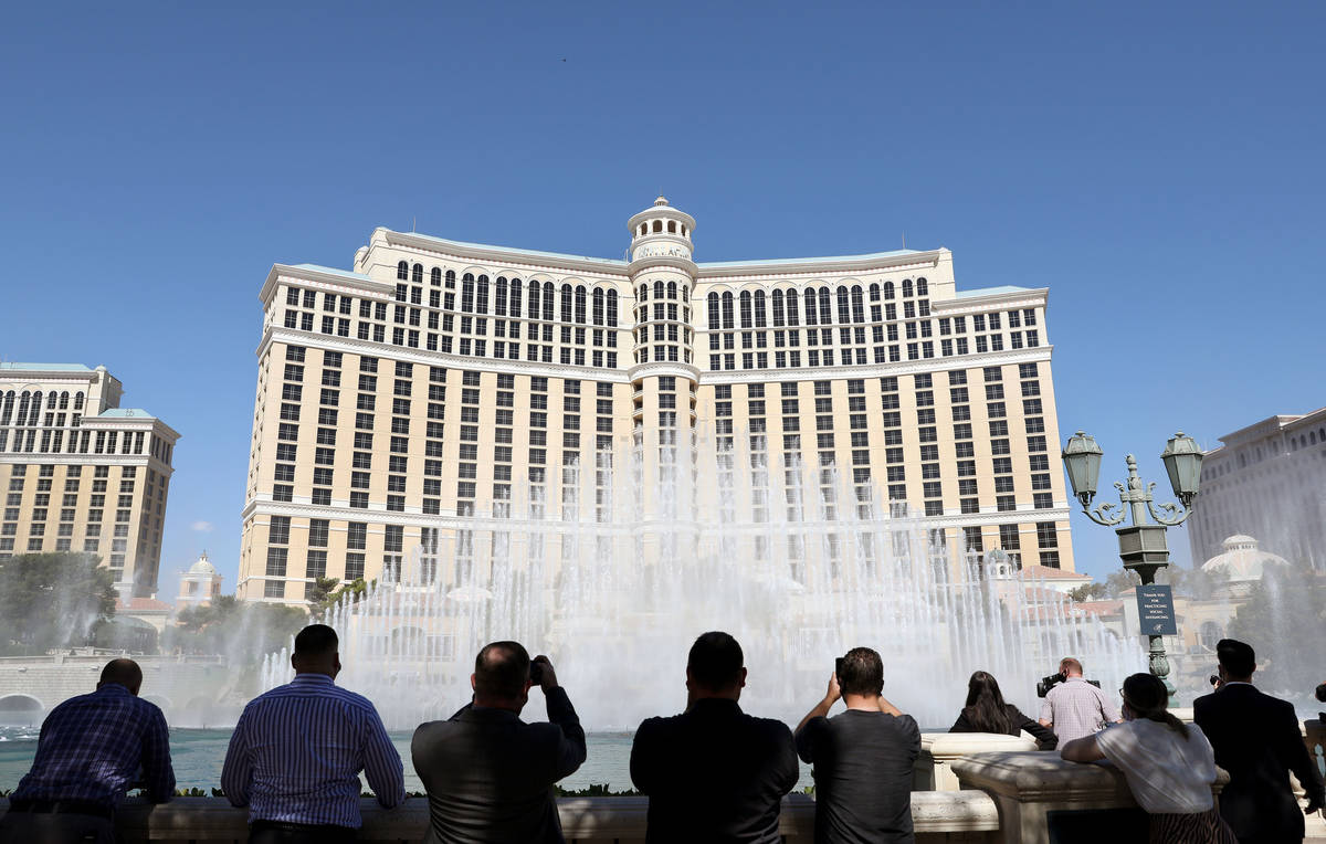 """Individuals watch the """"Simple Gifts"""" Bellagio Fountain show as a tribute to frontline ..."""