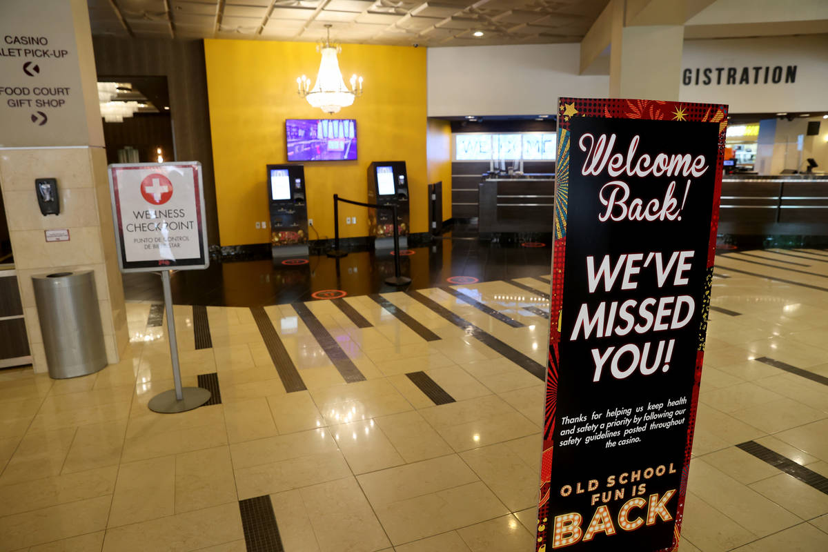 Signs welcome guests back to the Plaza in downtown Las Vegas Wednesday, June 3, 2020. (K.M. Can ...