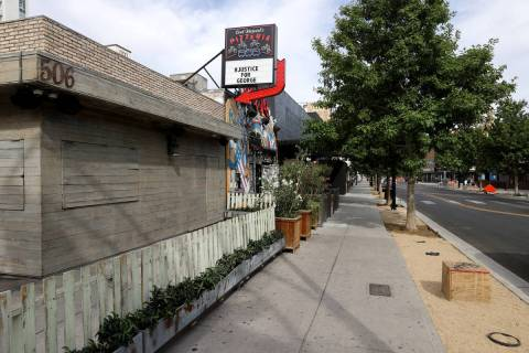 Park on Fremont, left, is boarded up and Evil Pie has a #JusticeForGeorge message on East Fremo ...