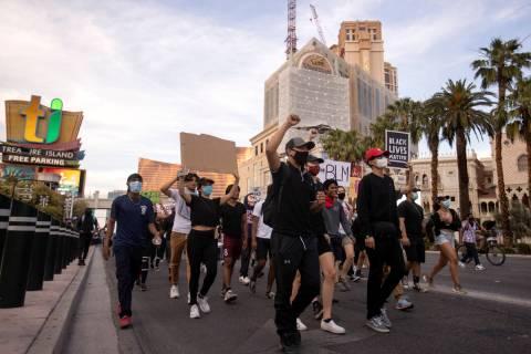Protestors make way down Las Vegas Boulevard in support of George Floyd, who was killed in cust ...