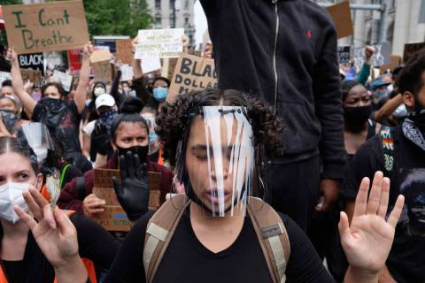 Protesters gather at Foley Square on Tuesday, June 2, 2020, in New York, as part of a demonstra ...