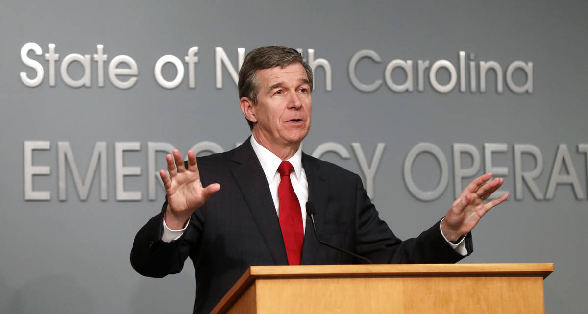 North Carolina Gov. Roy Cooper speaks during a briefing at the Emergency Operations Center in R ...