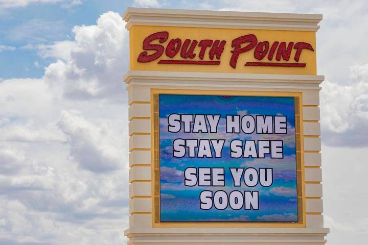 A South Point electronic marquee sign sends a message to stay home, at South Point in Las Vegas ...
