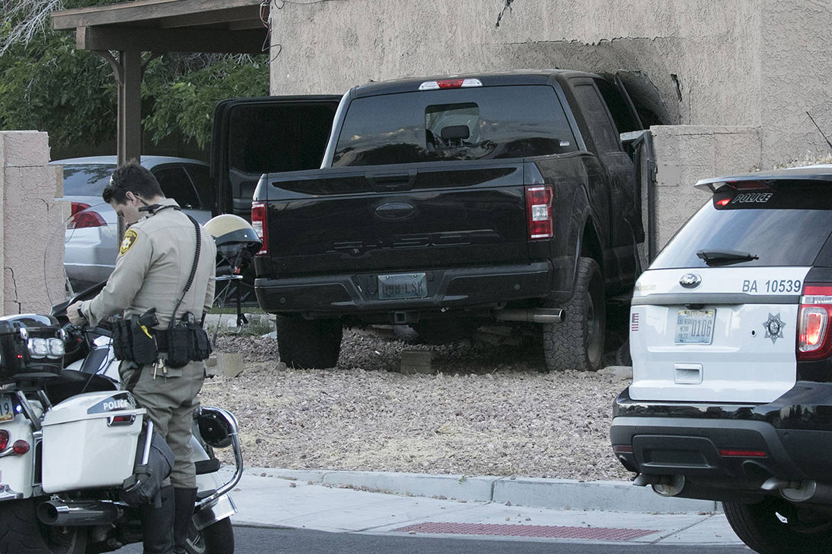 Las Vegas police investigate after a pickup crashed into a house at 401 North Torrey Pines Driv ...
