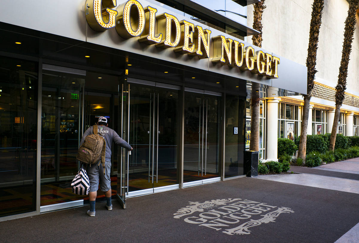 A man walks into the Golden Nugget as hotel-casinos reopen in downtown Las Vegas on Wednesday, ...